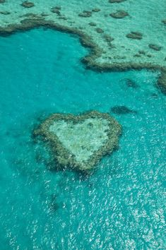 aerial view of Heart Reef, Great Barrier Reef, Australia Places Around The World, Oh The Places You'll Go, Places To Travel, Places To Visit, Cairns, Great Barrier Reef, Place Of Birth, Heart In Nature, Sunshine Coast