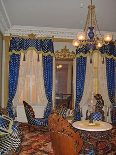 High Victorian 1880 - notice the beautiful overlay glass chandelier and parlor lamp