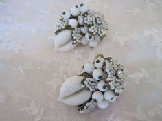 Miriam Haskell white milk glass earrings. via Etsy.