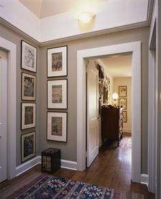 "A lovely neutral color - Benjamin Moore ""Bennington Gray"" and the picture arrangement"