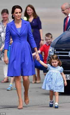 Catherine leaves Poland and arrives in Germany on the Poland and German visit with Prince William and the kids. She is wearing a Catherine Walker coat.