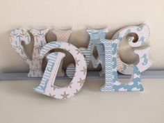A personal favourite from my Etsy shop https://www.etsy.com/uk/listing/253036876/baby-boy-nautical-custom-made-wooden