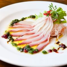 Elegant slices of fresh kingfish sashimi served with a shallot, umeboshi & tamari dressing from Uchi Lounge restaurant & sake bar.