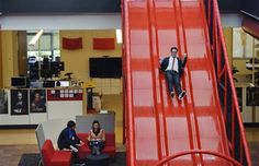 Chris Dale, Manager of Global Communications for Google and YouTube, goes down a slide at the YouTube's headquarters in San Bruno, California, on September 15, 2011.