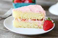 Strawberry Lemonade Cake Recipe on twopeasandtheirpod.com Tart lemon cake with fresh strawberries and strawberry buttercream!
