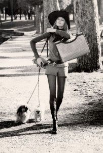 Veruschka in Valentino boots walking her dogs in the Borghese Gardens