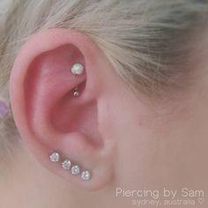 478778837879 A fresh Rook piercing 🙌💎 pierced with a white opal gem