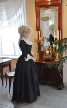 Before the Automobile: 1790 round gown. This is a mourning dress but I think that's only because it's black.