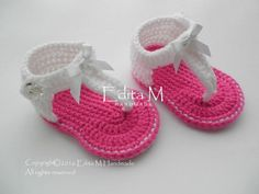 Crochet baby sandals. Made from acrylic yarn. Size : 9-12 months. Length: approx. 12,5 cm.- 5 inches  Hand wash in cool water.  You can find me on Facebook: https://www.facebook.com/EditaMHandmade/  If you have any questions, please contact me. Thank you for visiting.