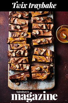 This Twix traybake recipe is a chocolate sponge studded with chunks of shortbread and topped with a luscious chocolate caramel icing and Twix slices. It makes a fabulous celebration cake Tray Bake Recipes, Baking Recipes, Cake Recipes, Dessert Recipes, Desserts, Dessert Bars, Baking Ideas, Chocolate Cheese, Chocolate Recipes