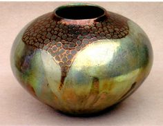 M.Wein trailed circles with copper Raku fired