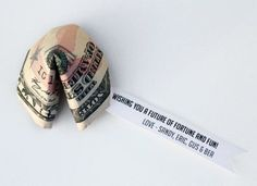 Fold any denomination bill into a cute fortune cookie. | 21 Surprisingly Fun Ways To Give Cash As A Gift