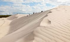 Tourists walking in the dunes at Slowinski National Park on the Baltic coast, Poland Krakow Poland, Warsaw Poland, Travel News, Travel Guides, Travel List, The Beautiful Country, Beautiful Places, Places Around The World, Around The Worlds