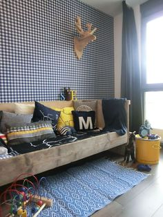 gingham wall and raw wood bed