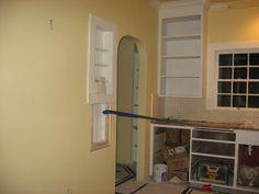 Kitchen - floors tiled, spice shelf truncated to preserve but make room for new base cabinet below it.