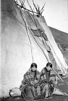 Umatilla women in front of large tepee,  Umatilla Reservation,  Oregon.   Photo by Lee Moorhouse.