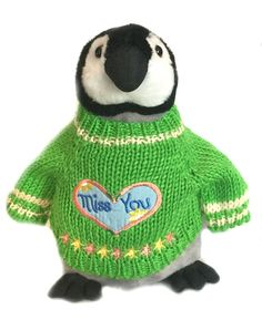 """Our Miss You Penguin Plush makes for a wonderful penguin addition for a friend or family member that's far away and in your thoughts. Measuring 10"""" tall, this adorable plush penguin is wearing a color"""