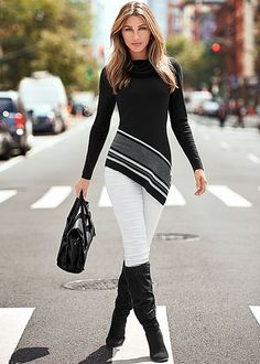 Start off the season in a traffic stopping outfit. Venus asymmetrical hem sweater with Venus color skinny jeans and Venus block heel boot. #Skinnyjeans