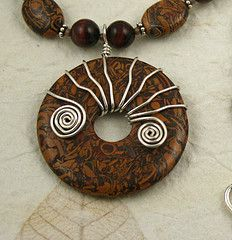 """wire wrapped donut - simple and effective.  You can """"tighten down"""" the spokes by grabbing with flat pliers and  twisting just a bit"""