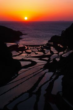 """When the Sun Goes Down"" - Japanese terraced rice fields in Saga, Japan-: photo by Junya Hasegawa, via 500px."