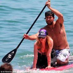 Avril Lavigne paddle boarding