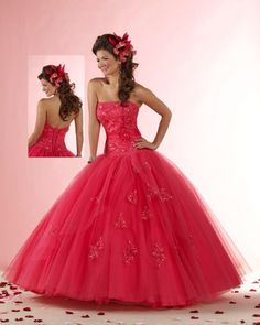 is a coral pink dress has rhinestones decorations litmus liston a pink coral at the waist with a flower in the center and has a decoration with rhinestones has a cost of twenty-three hundred pounds