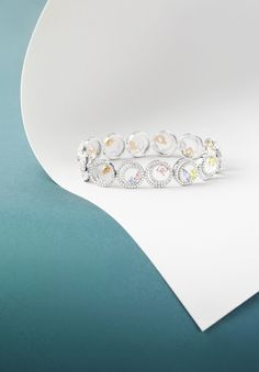 Boodles Finely Coloured - the 'Swirl' bracelet featuring a collection of fancy-shaped coloured diamonds within white diamond hoops.