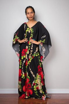 An amazing long trendy bohemian kaftan, which stands out from the crowd because of its contemporary design and gorgeous boho floral print. A glamour dress like you havent seen before. This long elegant garment looks like a classic styled dress at first but it features a funky, modern styled