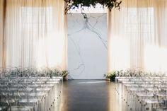 Sleek marble ceremony backdrop // Wedding backdrops