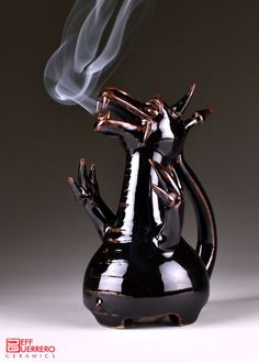 Smoking Dragon Ceramic Incense Burner. $199.00, via Etsy. Love the fact that it's a sculpture, would make it two pieces for use of cones. Love the handle for carrying, wouldn't have done a squatty bottle with carved feet for my base form. #form