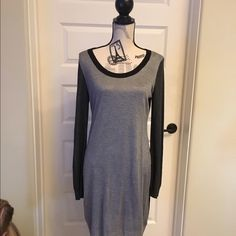 💋Sale💋 Adorable black and gray sweater dress Super cute for fall and winter time, looks great with leggings, boots and a long necklace. TAGS ON ,NEVER WORN !! ‼️ FIRM  ‼️ Pink Rose Dresses Long Sleeve