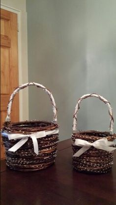 Twig, pearl and satin ribbon flower girl baskets