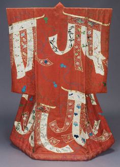Long-sleeved outer robe (uchikake), 1800-1867, Japan,  for wedding of red silk damask ground with woven pattern of interlacing lines and sprays of flowers and surface design of curtains (kichô) made from lengths of red and white fabric, on which are embroidered flowers, tortoise, cranes and butterflies with pink, blue, green, yellow, black, gray and brown silk and gold thread; MFA. (William Sturgis Bigelow Collection)