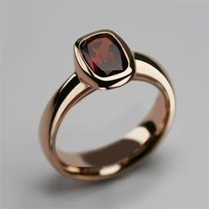 menus Beautiful 9 carat rose gold & garnet Halo ring handmade in our London workshops. Stephen Einhorn's unique and contemporary design can also be made in 14 & 18 carat rose gold Eye Jewelry, Jewelry Rings, Silver Jewelry, Jewellery, Fashion Jewelry, Gold Ring Designs, Silver Rings Handmade, Garnet Rings, Beaded Rings
