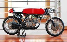1960's Honda RC166 a vintage racer and the exact bike the model was used to copy. It's impossible to tell the 2 apart.