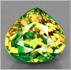 You can see the amazing dispersion in this high quality facetted Titanite Sphene! I don't have it in my possession, but I'd love to!