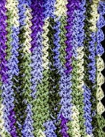 Cluster stitch Afghan. I like the colours and stitch, reminds me of Wisteria! Part of a free collection of patterns for Afghan designs.