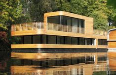 Check out this beautiful modern German houseboat by architects Rost Niderehe on Eilbek Canal near Hamburg