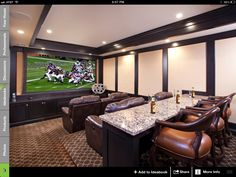 Theater room: Not the style or colors, but love the bar with seats in the back