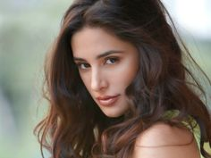 Celebs - GupShup: Nargis Fakhri Launches Own Website