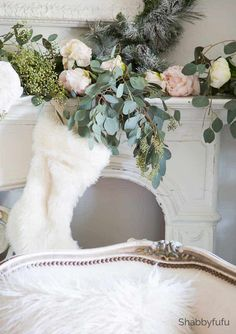 French country Christmas celebration in the living room with a white flocked tree and how to design a similar look. A King of Christmas white flocked tree.