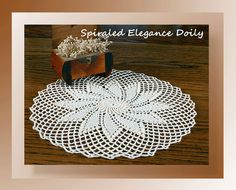 """If you love spirals/pinwheels and popcorn stitches, this doily is perfect.  It's what I think of as """"simple elegance.""""  Brush up on your skills using thread and create a doily that will bring joy for many years to come!"""