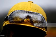 Cling film covers the goggles of a jockey on a wet day at Chepstow racecourse on November 18, 2015 in Chepstow, Wales.