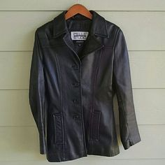 WILSONS black leather jacket Genuine black leather jacket. 4 button closure. Slit pockets in front. Wear on the shoulders (shown in last pic) I wore it quite a bit and could use a professional leather cleaning. Small normal wear spots. It could totally be worn as is to but there are spots. Signs of wear at the bottom of sleeves as well. Happy to post more pics if interested in purchasing. Also the top button is loose and could use a tighter stitching. Wilsons Leather Jackets & Coats