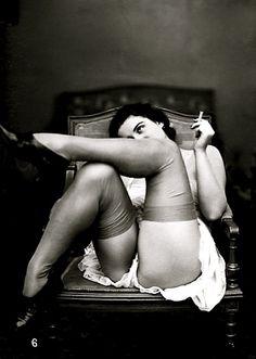 Femme dans un fauteuil, French postcard c1920s