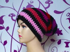 Cute beanie, black and red/pink/purple stripes.