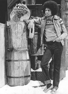 Michael Jackson and Oscar the Grouch.  There were two Sesame Street Christmas specials produced in the late 70s; I believe this still is from the truly awful CBS special.