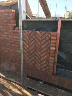Heringbone brickwork above lintels