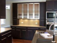 Dark modern cabinets with wood floors. Black Kitchen Cabinets, Built In Cabinets, Modern Cabinets, Black Kitchens, Kitchen Appliances, Dark Cabinets, Reface Cabinets, Glass Cabinets, Maple Floors