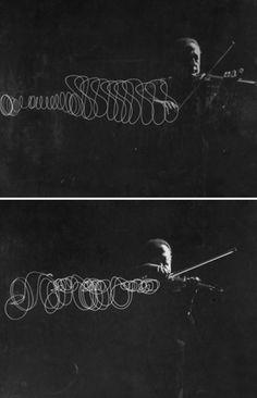 Gjon Mili - Jascha Heifetz playing in mili's darkened studio as light attached to his bow traces the bow movement, New York, 1952 @ life Jascha Heifetz, Gjon Mili, Bow, Studio, Photographs, Movie Posters, Inspiration, Sweet, Music
